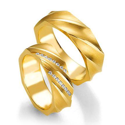 Обручальные кольца из желтого золота с бриллиантами на заказ