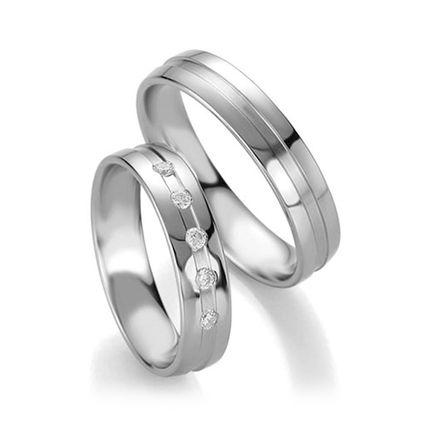 Обручальные кольца из белого золота с бриллиантами на заказ