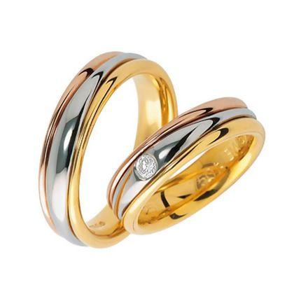Обручальные кольца из комбинированного золота с бриллиантом на заказ