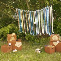 Фотозона. Ленты, ротанговые шары, сетки, коробки стилизованные под пиратские сундуки. Пляжная свадьба (Фото Perlamutro)