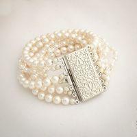 """Шикарный браслет """"Эвелина"""" украшен белым жемчугом Сваровски и кристальными бусинами Сваровски. Выполнен в семь нитей, которые завершает изумительная застежка.Возможные варианты цвета: белый, айвори"""