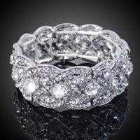 Цена: 499 грн. Праздничный браслет с кристаллами Сваровски белого цвета на толстой, прочной резинке. Длина - 16,5 см., высота - 2,5 см.