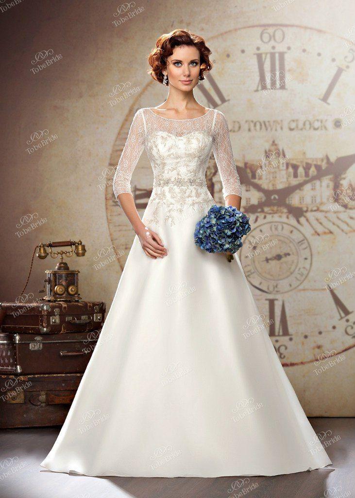 """Пышное белое платье с закрытым корсетом расшитым серебряными нитями и бисером и рукавами длинной три четверти - фото 2972295 Салон свадебной и вечерней моды """"Белый Танец"""""""