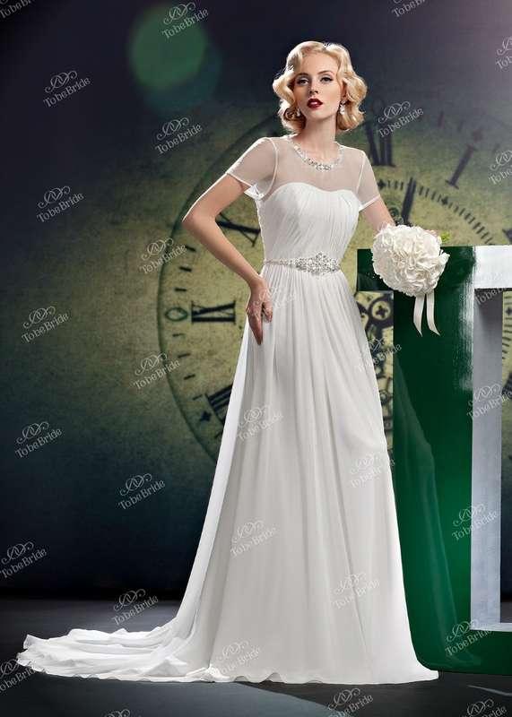 """Прямое платье с закрытым фатиновым верхом с короткими рукавами и поясом из бисера на талии - фото 2972333 Салон свадебной и вечерней моды """"Белый Танец"""""""