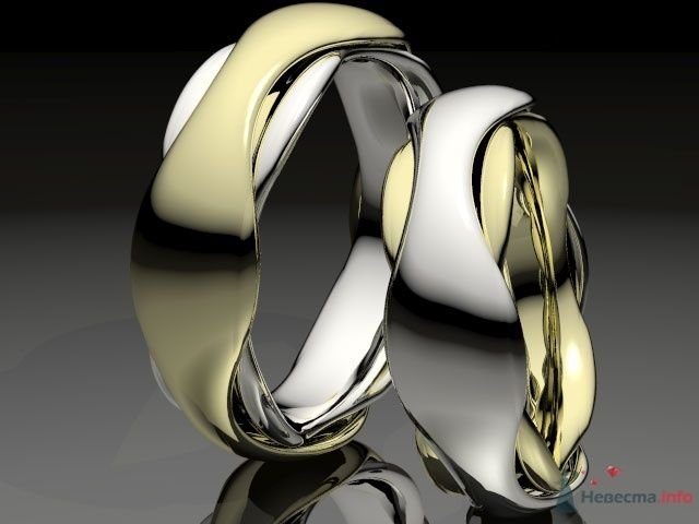 """Обручальные кольца из белого и желтого золота, на фоне зеркальной поверхности. - фото 25545 Ювелирная мастерская """"Золотая модель"""""""