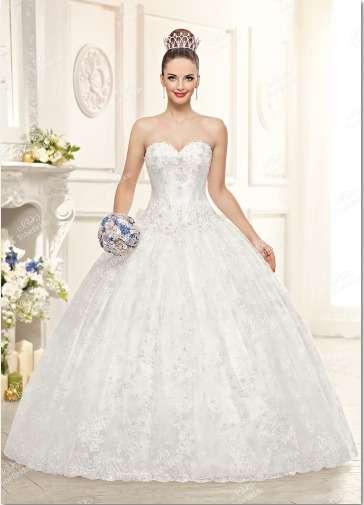 """Роскошное  свадебное  платье . Богато  расшитый   лиф  и  пышная   юбка,  отделанная  кружевом - это   платье  словно  наколдовано  доброй  феей!В  нём  любая  невеста  почувствует  себя  героиней   из   волшебной  сказки!Ткани  и  отделка:   атлас,  фати - фото 11963816 Интернет-магазин свадебных платьев """"Fleur d'Orange"""""""