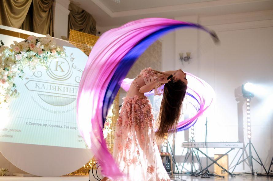 Восточный танец с поями