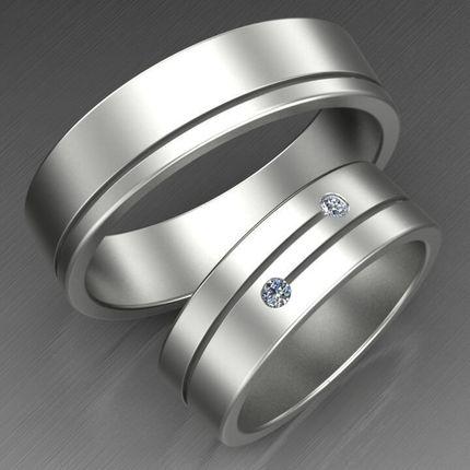 Пара обручальных колец из белого золота с бриллиантами. На заказ