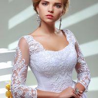 Екатерина. белое айвори, 40-44, 44-48, 48-52. Пышное атласное платье, с нежными рукавами 3/4 и оригинальным декольте. Кружева на юбке впереди и сзади.